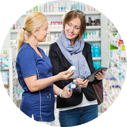 pharmacist assisting young woman