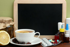 medicines and a cup of coffee