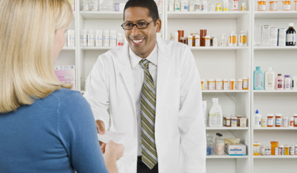 pharmacist entertain customer