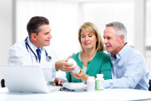 pharmacist assisting old couple